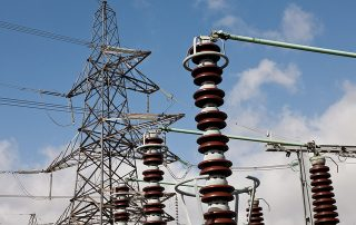 "A new report from MPs scrutinising the government's energy policy has called for significant and wide-ranging changes to the UK's grid governance and policy landscape if the country is to transition towards low carbon network infrastructure. The energy and climate change (ECC) select committee released its latest report on 17 June, which criticises both the government over its slow pace in developing energy policy and the current organisation of the UK's grid infrastructure. It judged that while developing low carbon electricity is key to the UK's decarbonisation ambitions, the current charging regime is not fit for purpose when addressing the ""astounding"" rise in new connection requests, particularly on distribution networks. Using solar as an example, the report states: ""The UK's installed solar capacity is approaching levels previously expected by 2030, stacking pressure on regional distribution networks. There is a need for better integration of connection and planning-consent processes."" Charging for distribution network connections As well as calling for the establishment of a cross-departmental working group to investigate and report on these improvements, the committee also suggests that charges be applied to generators requesting a connection to distribution networks. Currently, distribution network operators (DNOs) are required to offer a grid connection to any generator on a first-come-first-serve basis, with no up-front application fees. The committee claims this is problematic as it attracts a number of speculative applications which cause a backlog in projects seeking connections. Tony Glover, director of policy at the Energy Networks Association, is quoted in the report claiming ""about 70% of applications to connect are in fact speculative"". The report therefore suggests that the government should consider allowing DNOs to charge for connections, but that ""a sweet spot"" should be found between the minimum fee required to discourage speculative applications, and a level that would be a significant disincentive to the development of new generation. Distribution System Operators and changes to National Grid As well as this, the committee has also suggested significant changes to the role of DNOs to reflect the growth of electricity generation at a locally distributed, rather than transmission, level. Currently, DNOs are considered to be ""somewhat blind to their energy flows and passive in managing them"" and so the report suggests a transition to fully-functional distribution system operators (DSOs) which balance and control their local grids. DSOs would take up more of an operator function, using smart technologies to balance energy flows at a distribution level as the National Grid does for national transmission. The benefits of this change are deemed to be ""near-universally acknowledged"" yet the report states that the government has failed to set out a possible road map for this change. It therefore calls for the government to develop and publish a plan for DSO introduction, identifying future legislative and regulatory changes needed. It also suggests that a requirement be placed on small-scale generators to provide real-time information to DSOs. In addition to changes in the distribution network, the ECC committee has also called for significant reforms to the transmission network after levelling scathing criticisms at the National Grid. It claims the transmission network operator could be considered subject to potential conflicts of interest which would undermine the development of low carbon network infrastructure. Namely, it claims that National Grid can currently benefit from 'asset paddling', meaning it can advocate more capacity than needed in order for these assets to be built and then owned by National Grid. By being in the position of both benefitting from asset development and being in an influential position to recommend it, the select committee claimed National Grid could undermine the development of low carbon network infrastructure needed at a distributed level. It therefore suggests the formation of an Independent System Operator (ISO) which would take on the transmission system operator function from National Grid, which would become solely the transmission asset owner. ""Despite strong efforts by National Grid itself and Ofgem to mitigate the potential for conflicts of interest, it seems intractable and growing. Unnecessary asset development, or giving interconnectors an unfair advantage over existing and emerging balancing tools, could dilute the impact of other efforts to develop low-carbon network infrastructure,"" the report claims. The Department of Energy and Climate Change (DECC) has purportedly expressed a desire to move towards this new model but has failed to publish anything of note on the subject. The committee has therefore urged DECC to set out its intentions regarding an ISO as soon as possible, and consult on a detailed, staged plan for their implementation, so as to avoid injecting uncertainty into the energy sector. ""Glacial pace"" of policy development Many of the findings of the report continue to point towards the slow pace of policy development at DECC in many areas in addition to grid governance and charging. It states: ""Government has been slow to present a clear, holistic plan for the evolution networks need. It seems instead to have disconnected policy ideas at various stages of implementation."" This is typified by the slow pace of rolling out smart meters, which the select committee claims is ""not progressing quickly enough to achieve the necessary mass to truly create a smart energy network."" Around 53 million smart meters are expected to be offered to homes and businesses across the UK, with DECC estimating that the technology could provide £1 billion worth of benefits to networks, among approximately £18 billion of wider benefits against the cost (approximately £12 billion) of their roll-out. However, the ECC committee claims there are significant questions about whether the scheme is on track to meet its 2020 goals. The report also points to the ""glacial pace"" with which regulation is adapting to storage technologies, which the committee sees as hugely important in transitioning to a low carbon network system in the UK. Overcoming regulatory barriers to storage are a dominant theme in the report, with the need for the technology to no longer be classed as a generator of significant importance. Its current status means storage is liable for balancing charges, which they are charged twice - once for 'consuming' the electricity they store, then for supplying it back to the grid - costing UK storage approximately £14.9 million annually. They are also double-charged the Climate Change Levy (CCL), all of which the select committee believes shouldn't be applied at all. The report suggests a new and distinct asset class be considered for storage, but adds that the government must first make its position on storage known. It states: ""The current regulatory conditions for storage are hindering its development. We welcome the government's consultative approach to this matter, but hope it will proceed with a sense of urgency. We urge the Government to publish its plans, as soon as possible, for exempting storage installations from balancing charges, and from all double-charging of network charges."" Angus MacNeil, chair of the ECC select committee, said: ""Innovative solutions—like storage and DSR— to 21st-century energy problems have been held back by legislative and regulatory inertia. The government has committed to addressing these issues, and we will hold them to account on making good on this promise. DECC must also learn lessons from these policy lags so as to be better prepared for ongoing changes."" It concludes: ""Our overarching message to the government is to take seriously the criticisms about its speed of delivery, as expressed in this report and elsewhere, and to learn lessons from its approach to energy networks that can be used to improve its change readiness in future."""